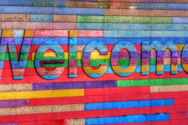 Rainbow Colored Sign that says Welcome